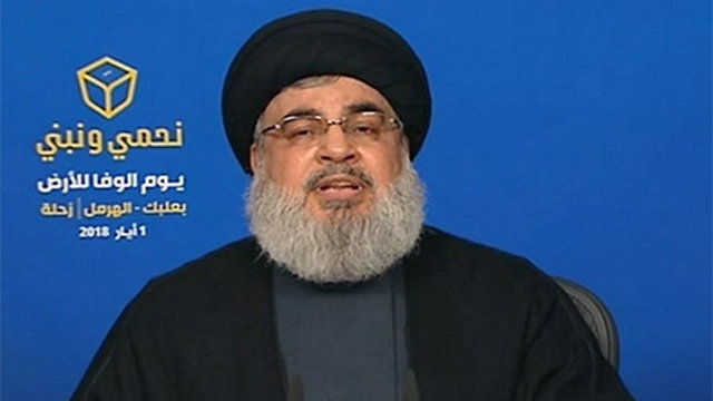 Nasrallah with the 'Defending and Building' slogan