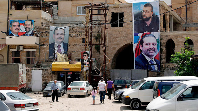 Election posters in Lebanon. Sixty-four seats for the Muslims, 64 seats for the Christians (Photo: AFP)