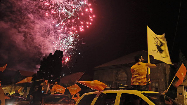Hezbollah supporters celebrate (Photo: AFP)