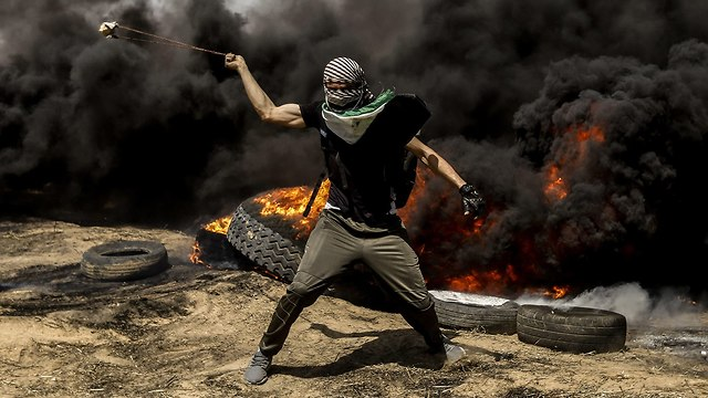 Rioter at Gaza border protest (Photo: MCT)