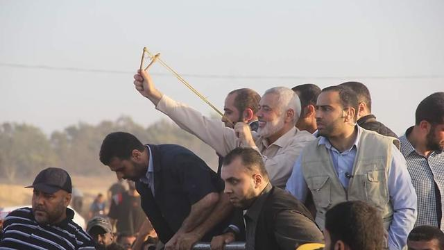Hamas leader Ismail Haniyeh with protestors on Gaza border