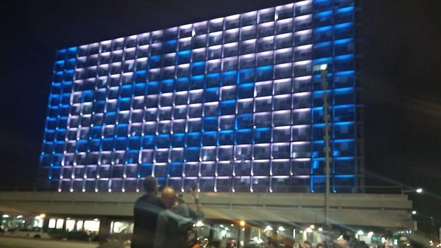 The Tel Aviv municipality building lights up with the Israeli flag