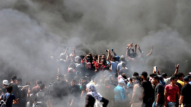 Palestinians rioting near the Gaza border (Photo: AFP)