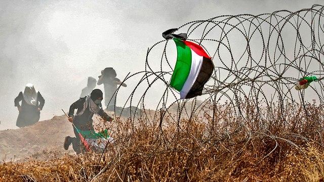 התפרעויות פלסטינים גבול רצועת עזה (צילום: AFP)