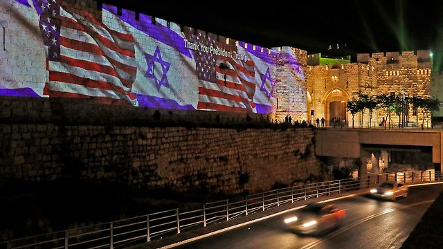 US and Israeli flags in Jerusalem (Photo: AFP)