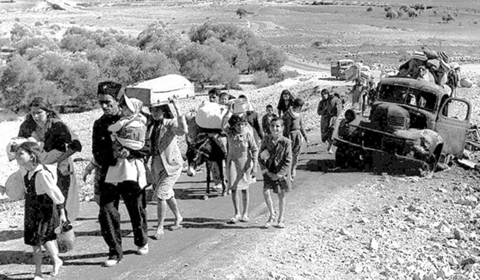 Palestinians leaving their homes during the 1948 Mideast War (Photo: Fred Csasznik)