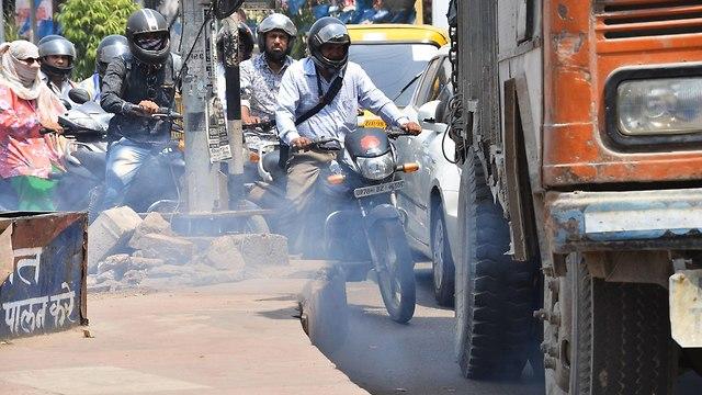 קנפור הודו העיר עם זיהום האוויר הגבוה בעולם (צילום: AFP)