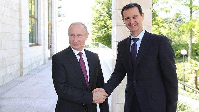 Russia's Putin (L) and Syria's Assad  (Photo: Reuters)