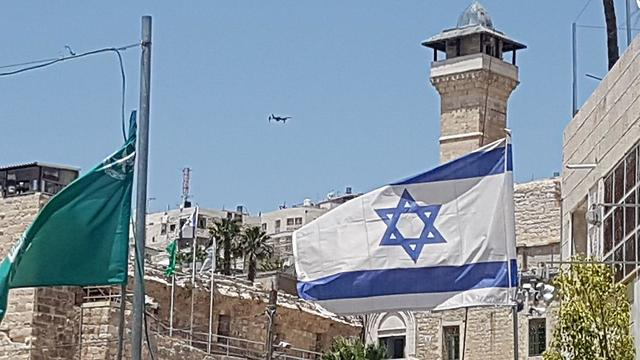An Israeli flag in Hebron. 'Every squad commander is aware of the importance of his mission'  (Photo: Yoav Zitun)
