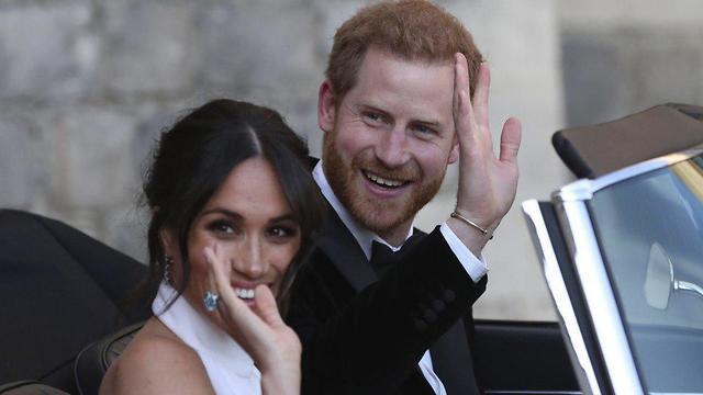 הנסיך הארי והדוכסית מסאסקס יוצאים מטירת וינדזור לקבלת פנים בבית פרוגמור, וינדזור (צילום: Getty Images)