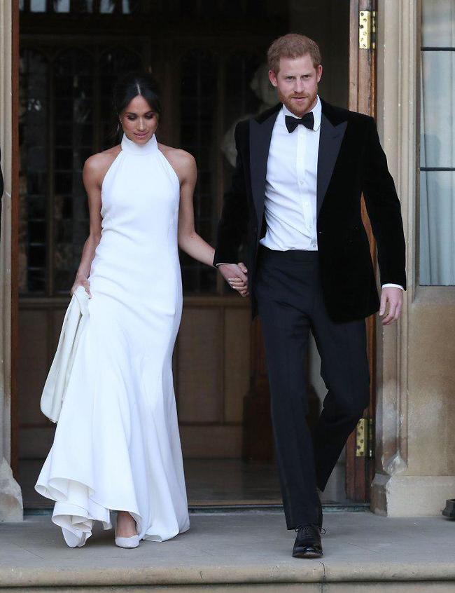 הסתדרת. מרקל והנסיך הארי (צילום: AFP)