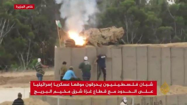 Terrorists stole into Israel, set fire to an abandoned IDF post and planted a Palestinian flag nearby