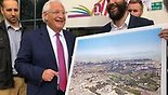 Amb. David Friedman holding a photoshopped picture of Temple Mount