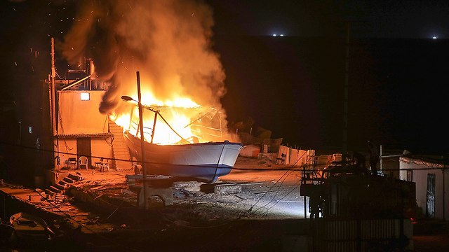 Fishing boat on fire off Gaza coast. The IDF retaliated to Tuesday's infiltration by destroying a Hamas terror tunnel and targets belonging to the organization's naval force (Photo: EPA)