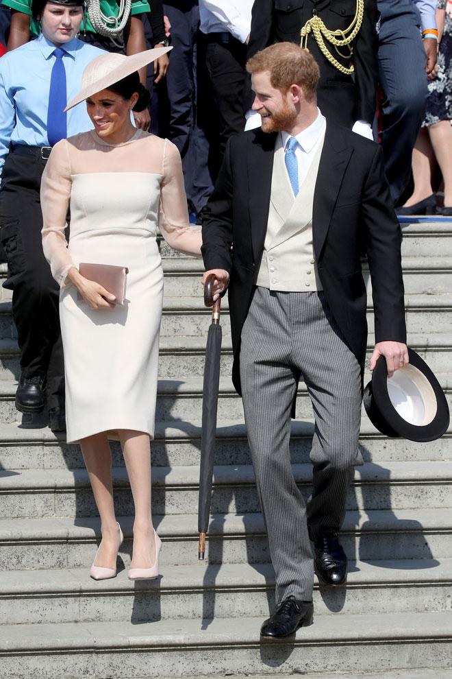"""מרקל עם הנסיך הארי. """"אני גאה להיות אישה ולהיות פמיניסטית"""". הקליקו על התמונה (צילום: Chris Jackson/GettyimagesIL)"""