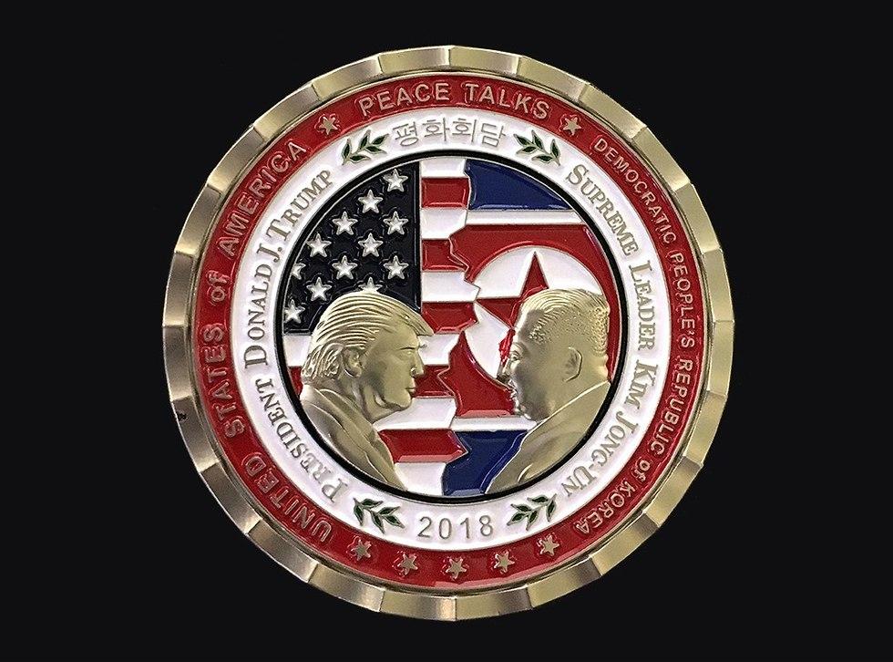 מטבע שהוכן על ידי הבית הלבן לקראת פגישה של דונלד טראמפ עם קים ג'ונג און  (צילום: EPA)