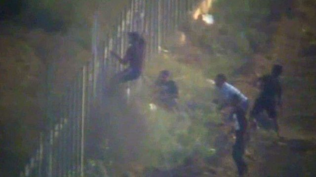 IDF footage of rioters scaling security fence (Photo: IDF Spokesperson's Unit)
