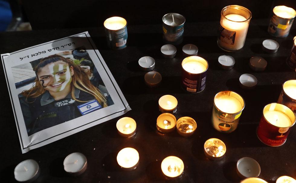 """נרות נשמה לזכר הדס מלכא ז""""ל, שנהרגה בפיגוע בירושלים לפני כשנה. למטה: השיר שבלום כתבה לזכרה (צילום: גדי קבלו)"""
