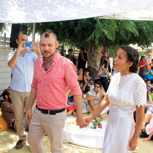 נופר רדע ועוז ירושלמי ביום החתונה (צילום: מיכאל זכודין)