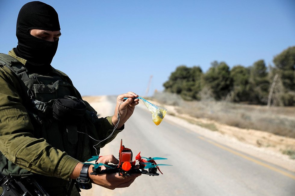 IDF soldier with drone that intercepted incendiary balloon from Gaza (Photo: Reuters)
