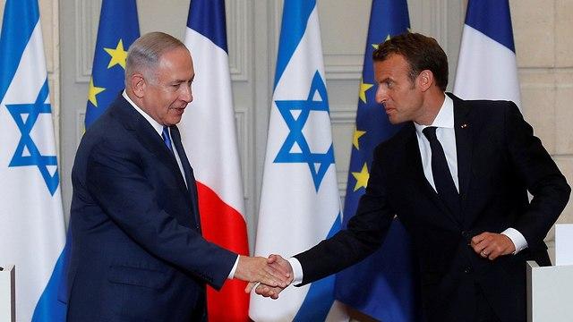 Netanyahu and Macron meet in Paris (Photo: Reuters)
