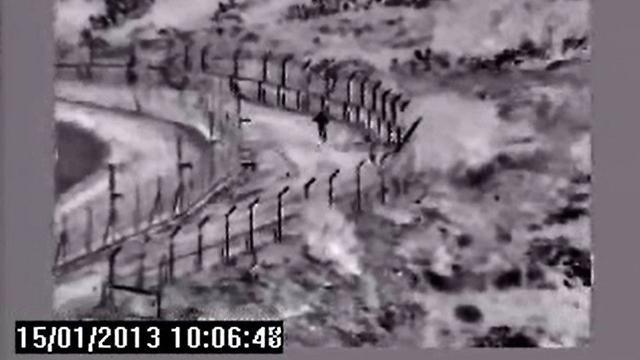 Awad climbing over the fence (Photo: IDF Spokesman's Office)