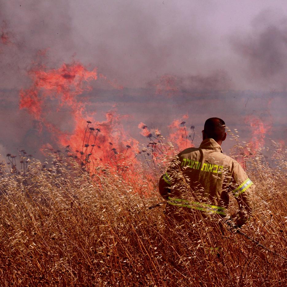 A firefighter in the fields of Kfar Aza. Photo taken by Varda Goldstein, 68 of Kibbutz Kfar Aza, a pensioner and the kibbutz's spokeswoman