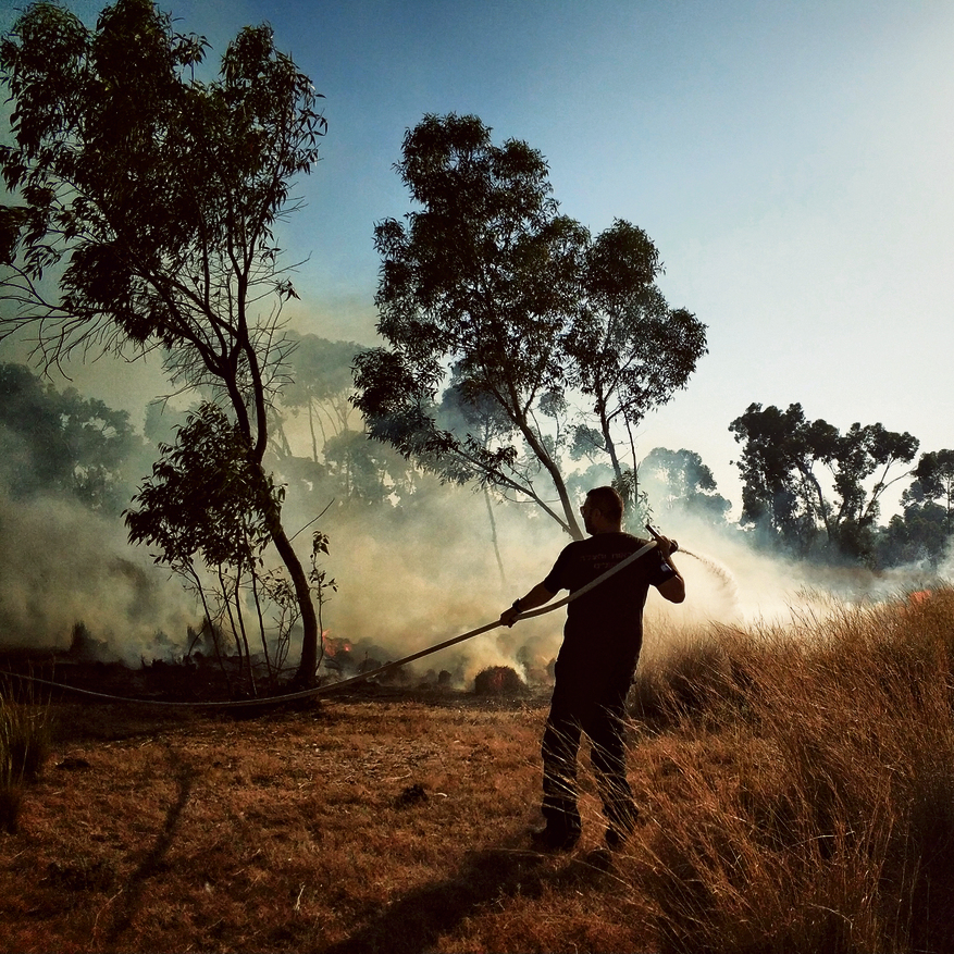 A fire near Kibbutz Be'eri. Photo taken by Ron Rahamim, 30, of Moshav Mivtahim, a professional photographer and photography teacher