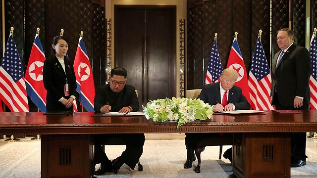 Trump and Kim sign the joint statement (Photo: Reuters)