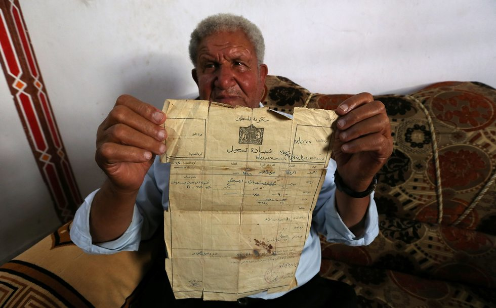 Palestinian Ahmed Jarghoun, 75, displays a land registration certificate from the British era (Photo: Reuters)