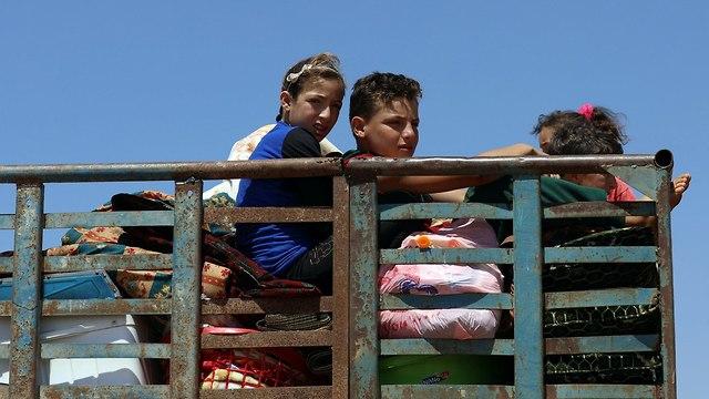 סוריה דרעא משבר הומניטארי הפצצות פליטים (צילום: רויטרס)
