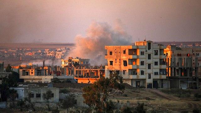 הפצצות בדרעא סוריה (צילום: AFP)