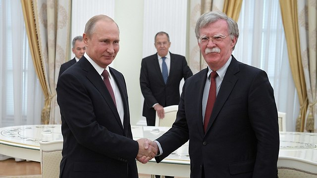 Putin with John Bolton (Photo: EPA)