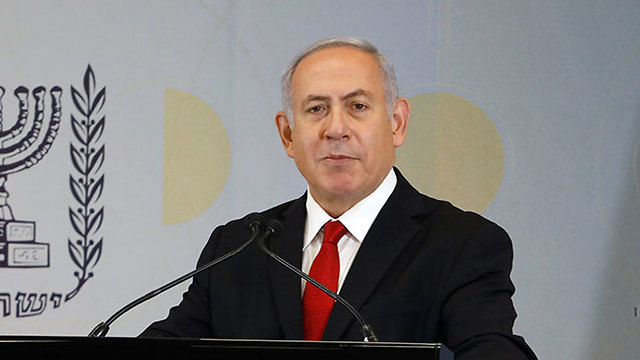 Netanyahu reading out the statement (Photo: Shaul Golan)