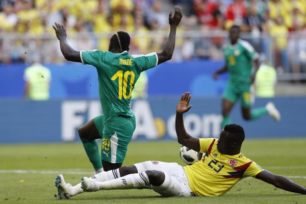 תיקול מושלם של סאנצ'ס על מאנה (צילום: AFP)