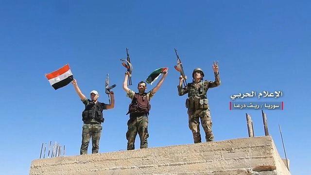 מורדים נכנעים לצבא אסד ()