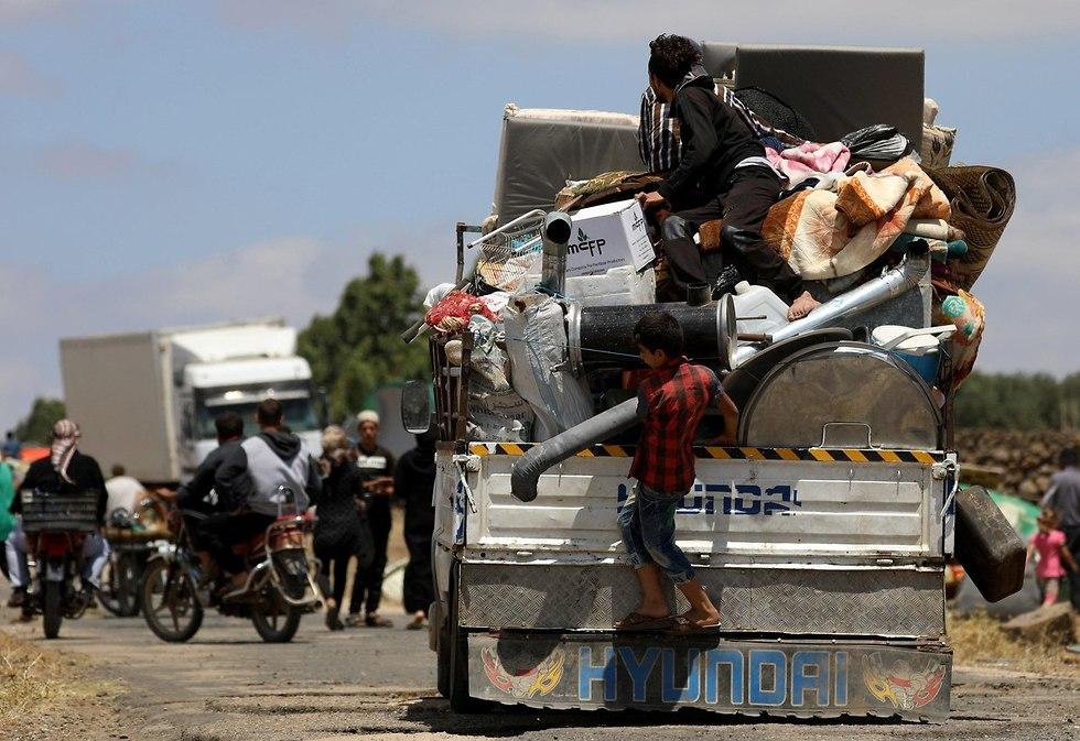 פליטים  (צילום: רויטרס)