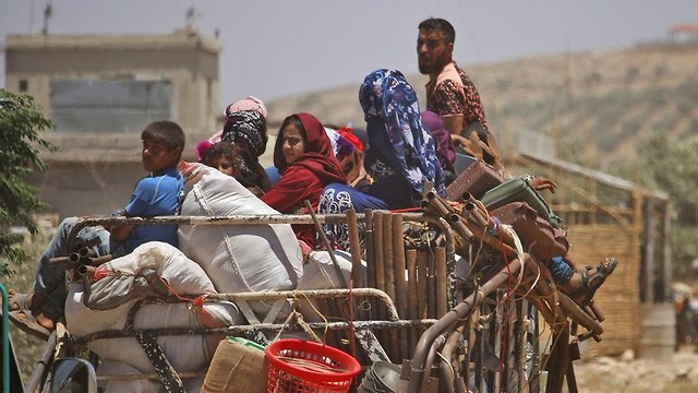 Refugees in the Deraa area, some fleeing towards Israeli border (Photo: AFP)