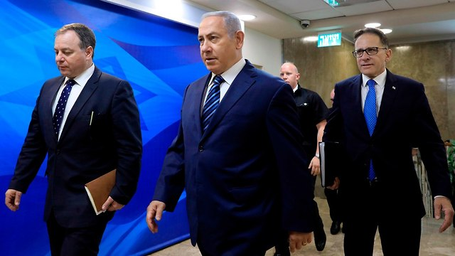 Prime Minister Netanyahu arrives for the weekly cabinet meeting (Photo: AFP)