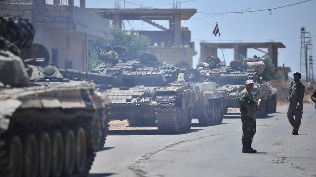 חיילים נאמנים לנשיא סוריה אסד במחוז דרעא (צילום: רויטרס)
