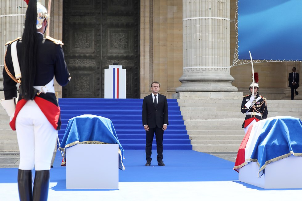President Macron stands by the coffins (Photo: EPA)
