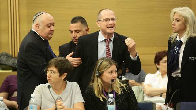 MK Oded Forer removed from the conference after interrupting the speakers  (Photo: TPS)