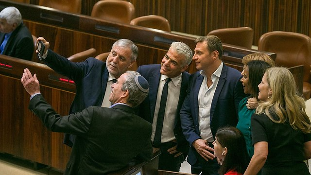 MK Stern takes a selfie with his Yesh Atid party colleagues after the bill's passage (Photo: Ohad Zwigenberg)