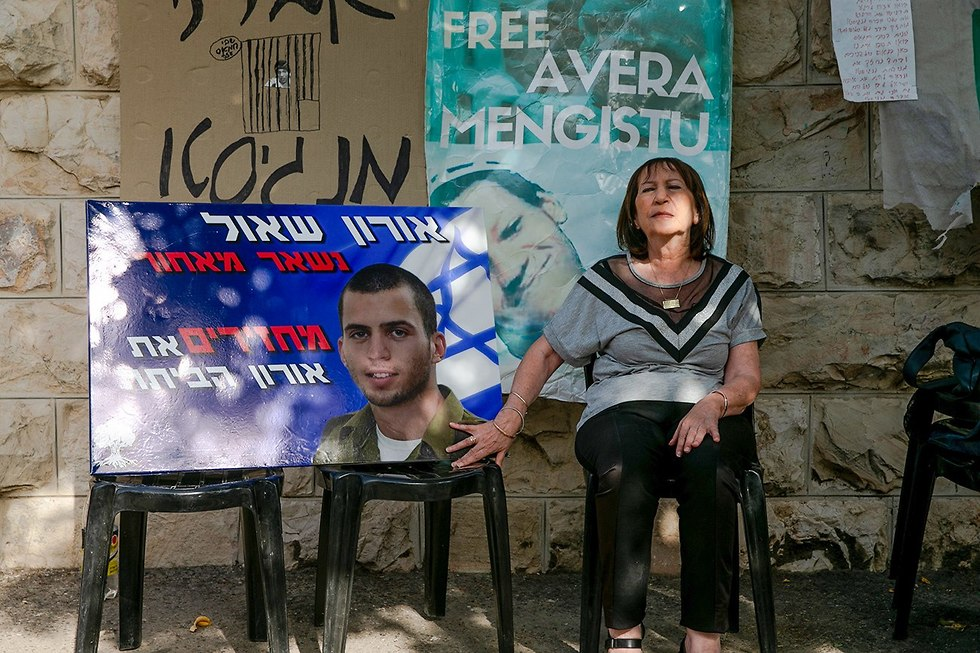 Zehava Shaul, Oron's mother, with a photo of her son (Photo: Ohad Zwigenberg)