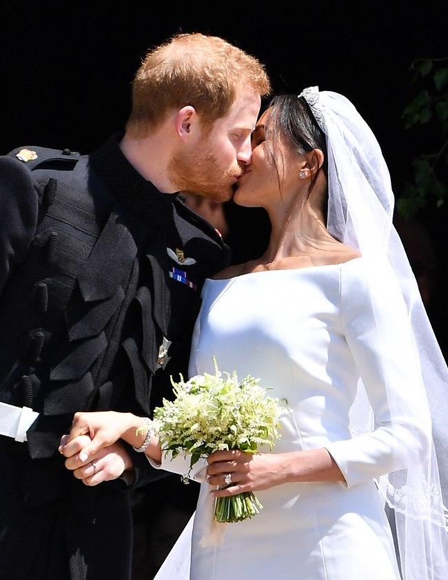 נשיקה של התגשמות חלום. מייגן מרקל והנסיך הארי (צילום: gettyimages)