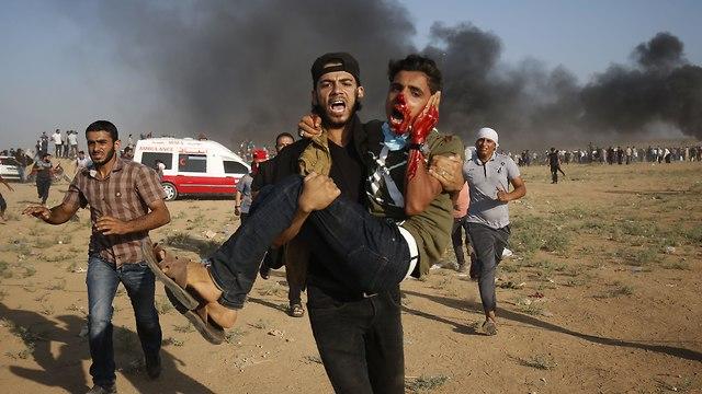 הפגנה הפגנות מהומות אלימות התפרעות התפרעויות גבול רצועת עזה פלסטינים צה