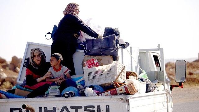 Refugees and rebels fled Daraa (Photo: AFP)