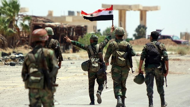 Syrian soldiers celebrating capture of Daraa