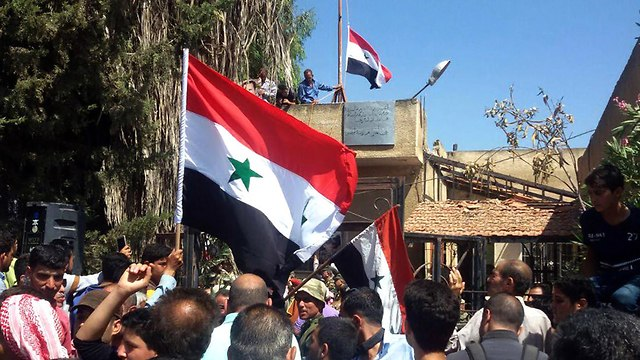 Syrian army celebrates capture of Daraa (Photo: AFP)