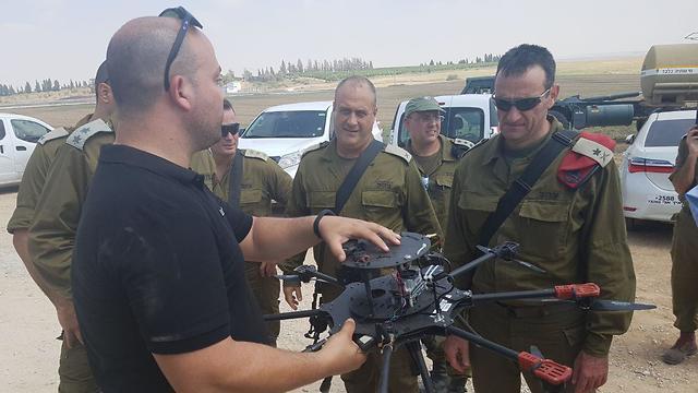 Maj. Gen. Halevi, right, and Brig. Gen Fuchs, center, shown the drone